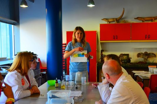Maddy Brasier explains the outcome of an ocean acidification experiment to workshop visitors on Sunday