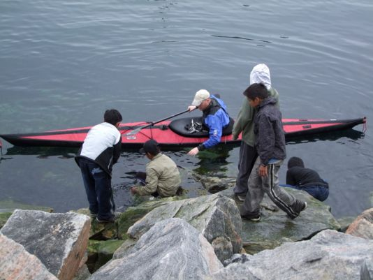 Catching capelin (small fishes) with the kids in Uummannaq harbour.